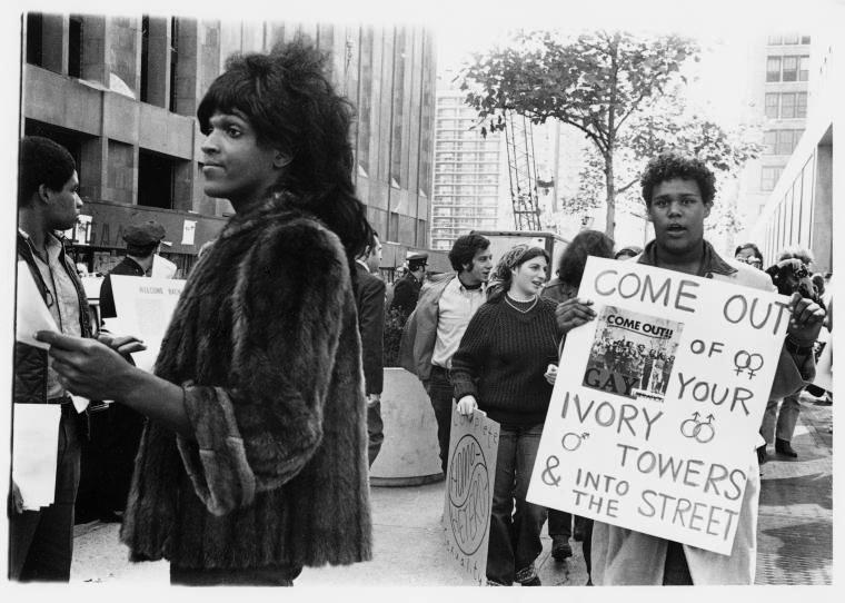 The+photo+depicts+Marsha+P.+Johnson%2C+an+African-American+gay+liberation+activist%2C+handing+out+flyers+in+support+of+queer+students+at+NYU+outside+of+Weinstein+Residence+Hall+in+1970.%0A