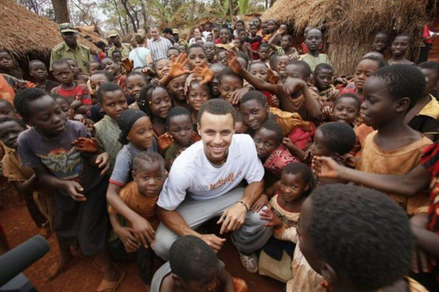 Golden+State+Warriors+point+guard+Steph+Curry+with+children+at+Nyarugusu+Refugee+Camp+in+Tanzania.+Curry+worked+with+Nothing+But+Nets%2C+a+charity+that+donates+malaria-preventing+nets+to+communities+across+Africa.