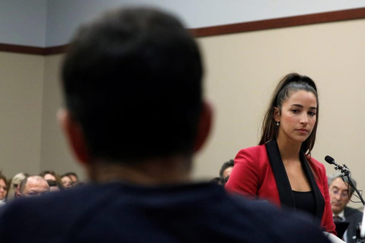 Olympic gymnast Aly Raisman testifying at Larry Nassar's sentencing on Friday, Jan. 19. Raisman is one of 100 plus women accusing Nassar of sexual assault.