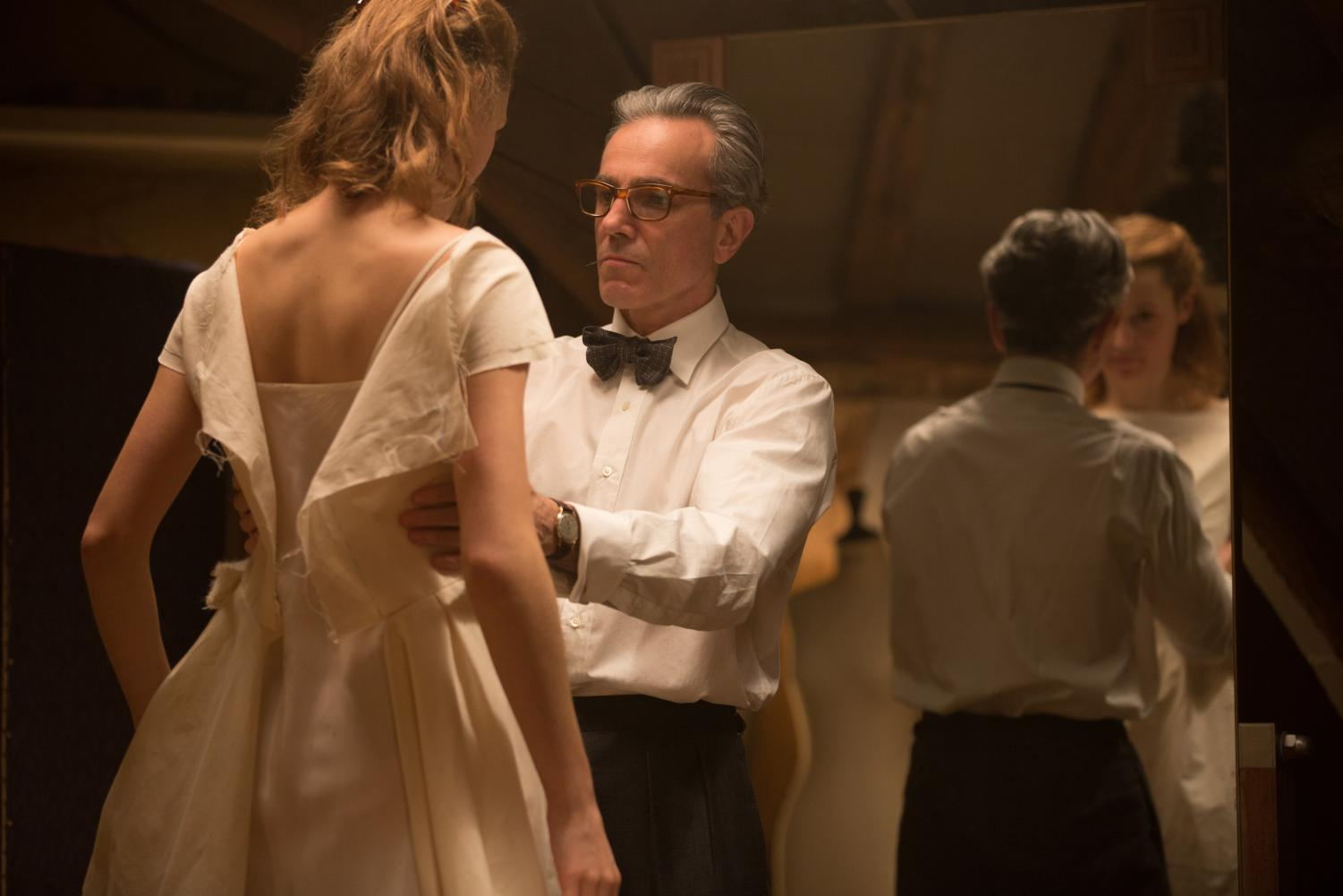 "Reynolds Woodcock, played by Daniel Day-Lewis, fits a dress on Alma, played by Vicky Krieps, in a scene from ""Phantom Thread."""