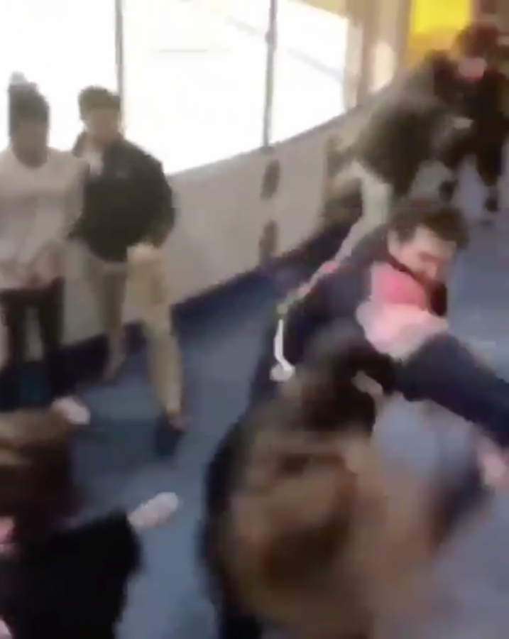 Screenshot+from+a+video+taken+during+the+fight.+The+fight+broke+out+immediately+after+the+game+when+a+fan+insulted+a+Syracuse+player.+