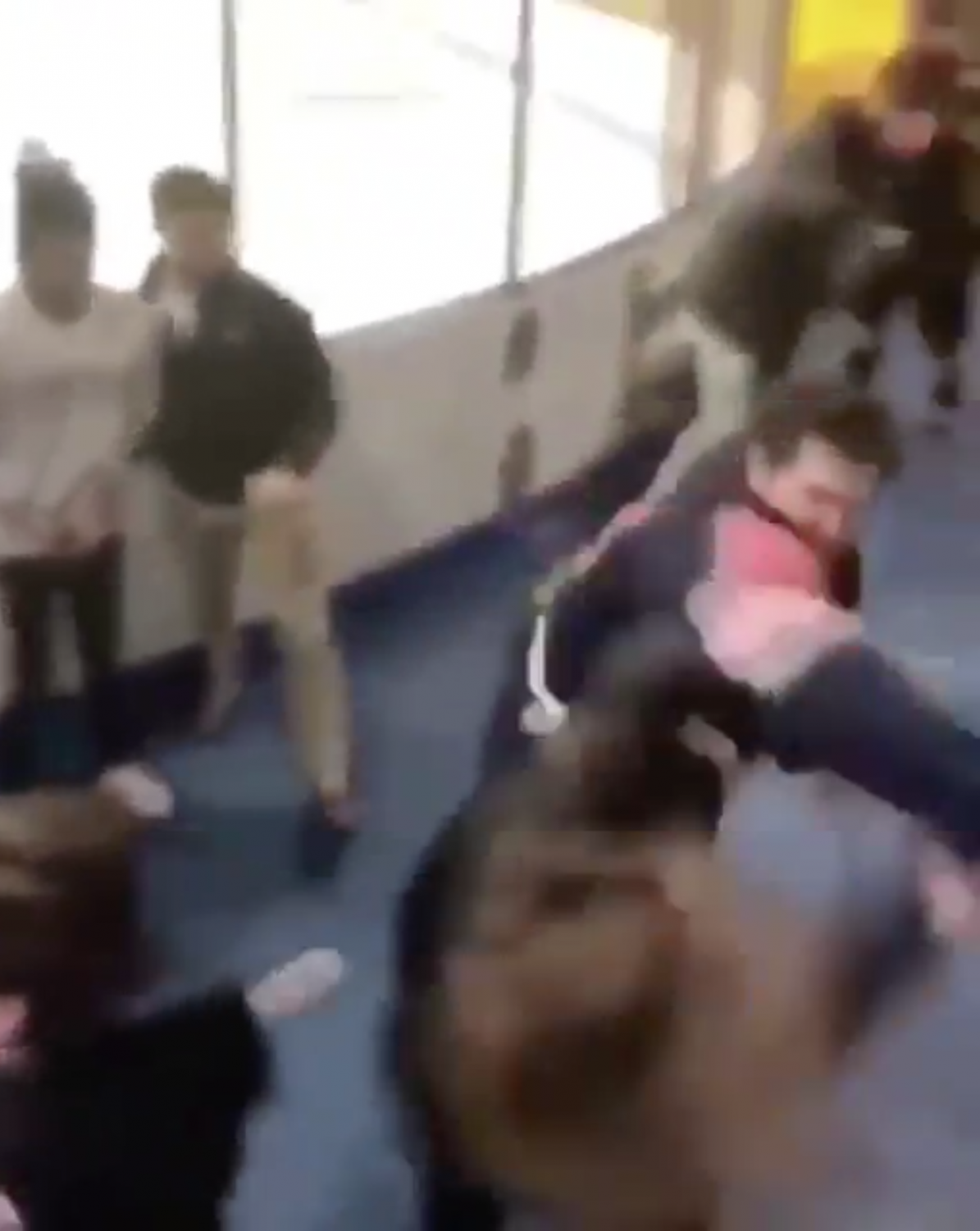 Screenshot from a video taken during the fight. The fight broke out immediately after the game when a fan insulted a Syracuse player.