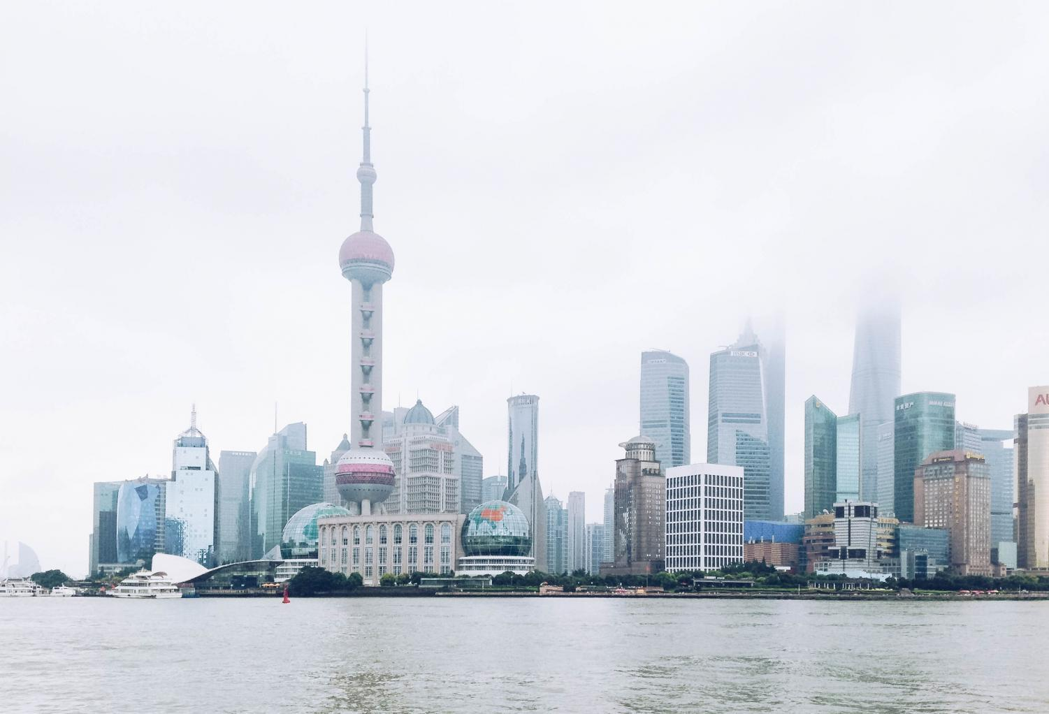 The Shanghai skyline on a foggy day.