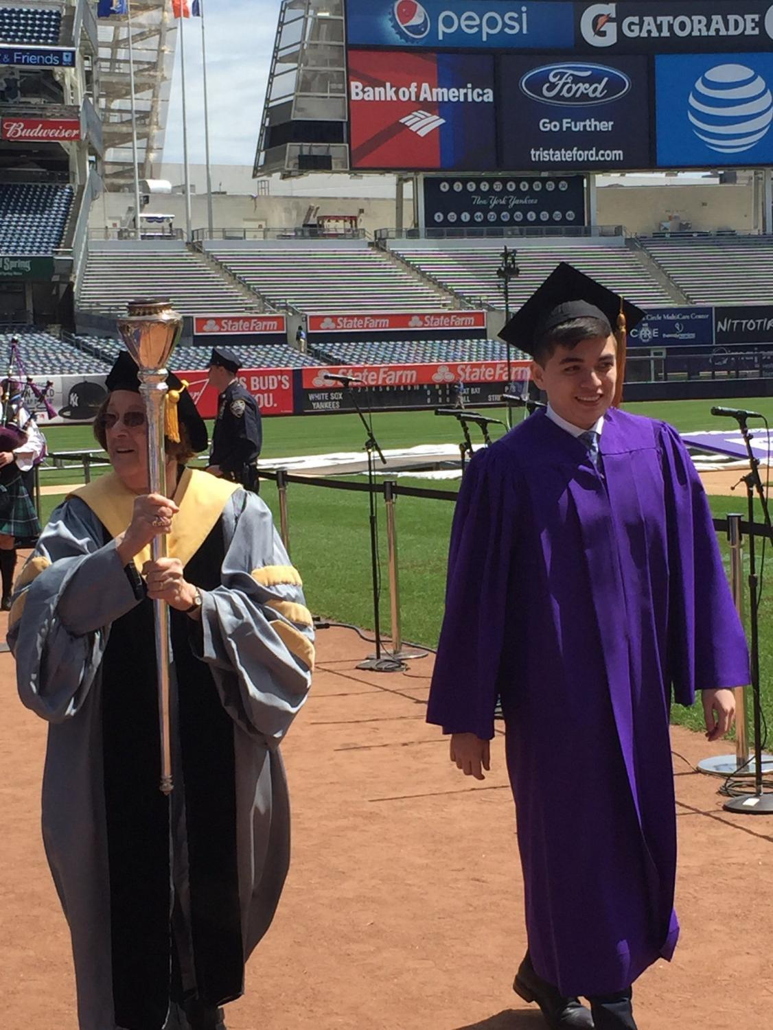 Azizjon Azimi (right) at the Class of 2016 commencement ceremony. Azimi was the youngest graduate in his class and is currently  pursuing concurrent degree program at Harvard and Stanford.