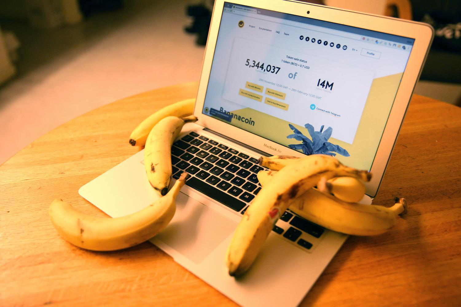 A laptop displaying the Bananacoin homepage.