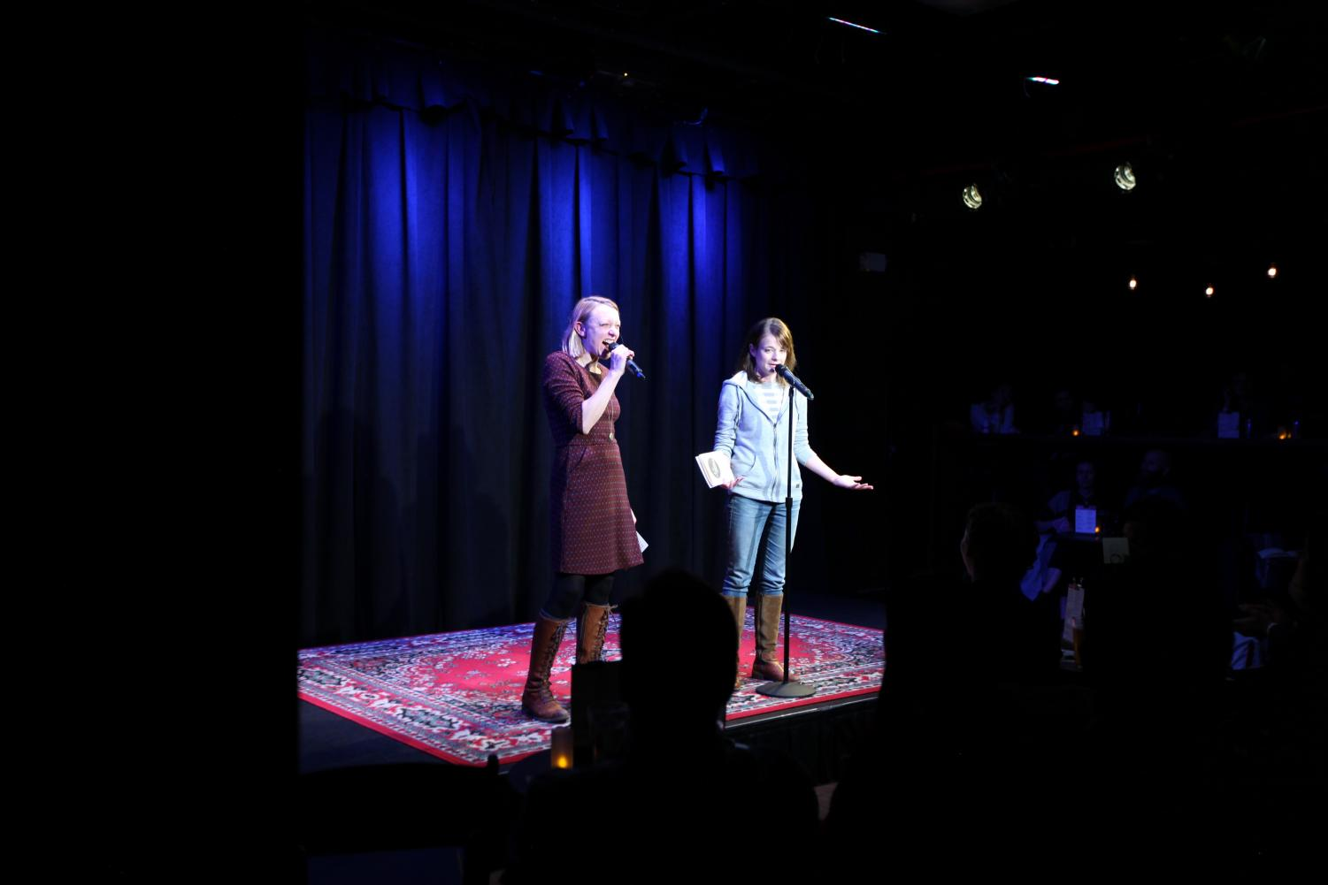 Paula Croxson (left) and Erin Barker (right) warm up the crowds before the first set of storytellers.