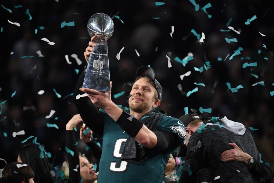 Philadelphia+Eagles+quarterback+Nick+Foles+holds+up+the+Superbowl+trophy+after+their+victory+over+the+New+England+Patriots+on+Feb.+4.
