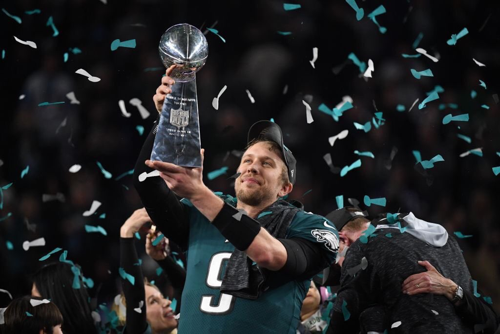 Philadelphia Eagles quarterback Nick Foles holds up the Superbowl trophy after their victory over the New England Patriots on Feb. 4