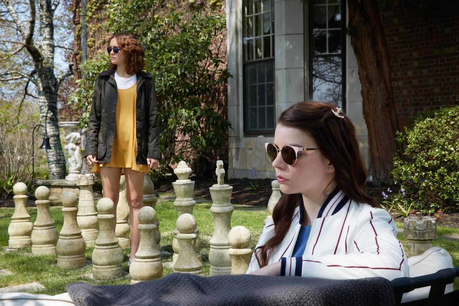 """Scene from the film """"Thoroughbreds"""" featuring Lily (Ana Taylor-Joy) and Amanda (Olivia Cooke)."""