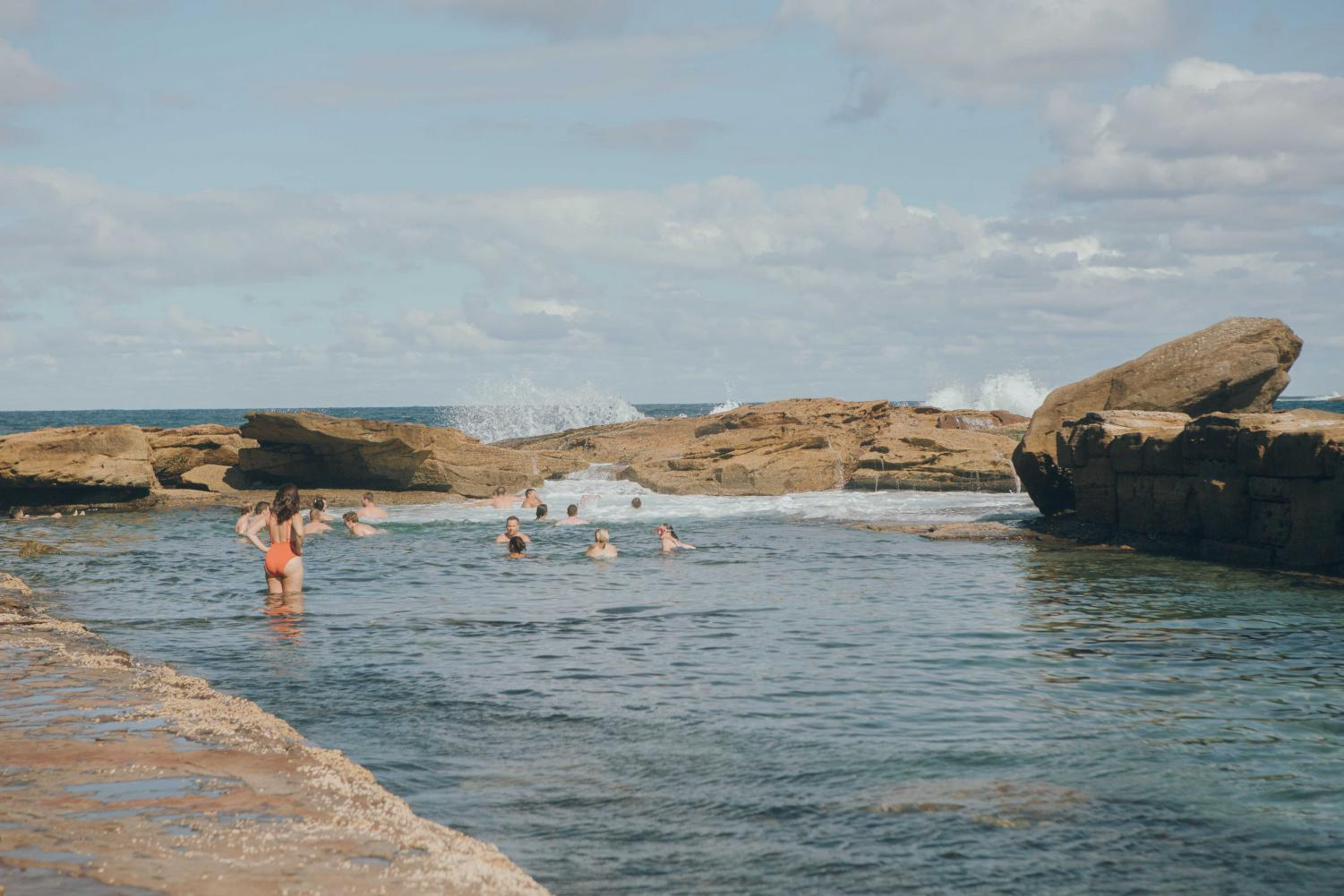 People relax in the rock pools at Coogee Beach in Sydney, Australia.