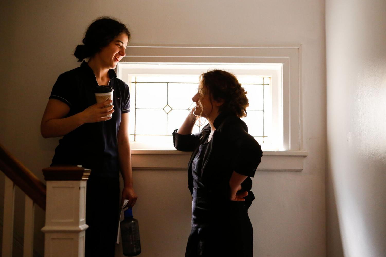 Emma Seligman and Rachel Sennott talking on the set of