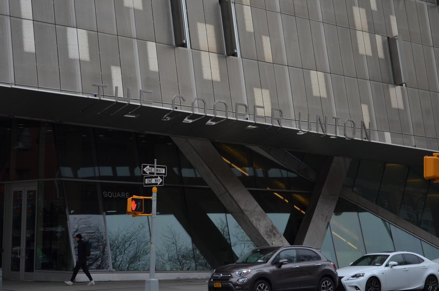A pedestrian walks past 41 Cooper Square, which houses many of The Cooper Union's classrooms and studios.