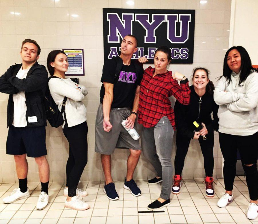 Coach+Kayleigh+Fournier%2C+NYU%E2%80%99s+head+strength+and+conditioning+coach%2C+posing+with+her+student+trainers.
