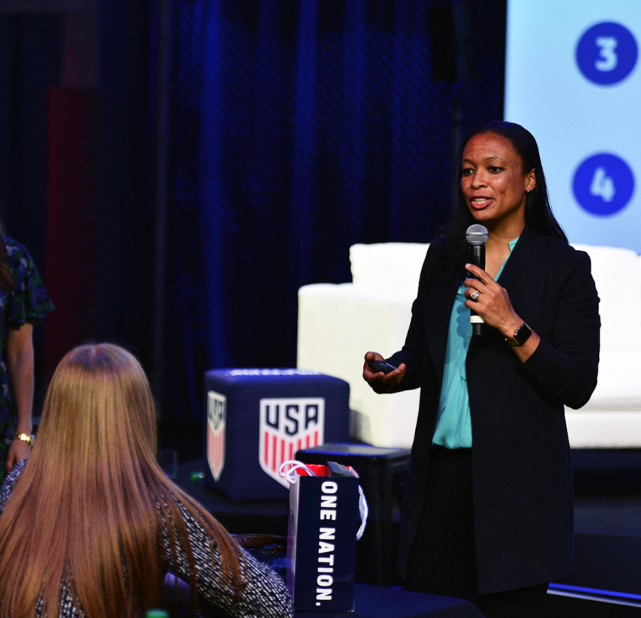 Former+USWNT+player+Angela+Hucles+speaking+at+the+SheBelieves+Summit+on+March+3.