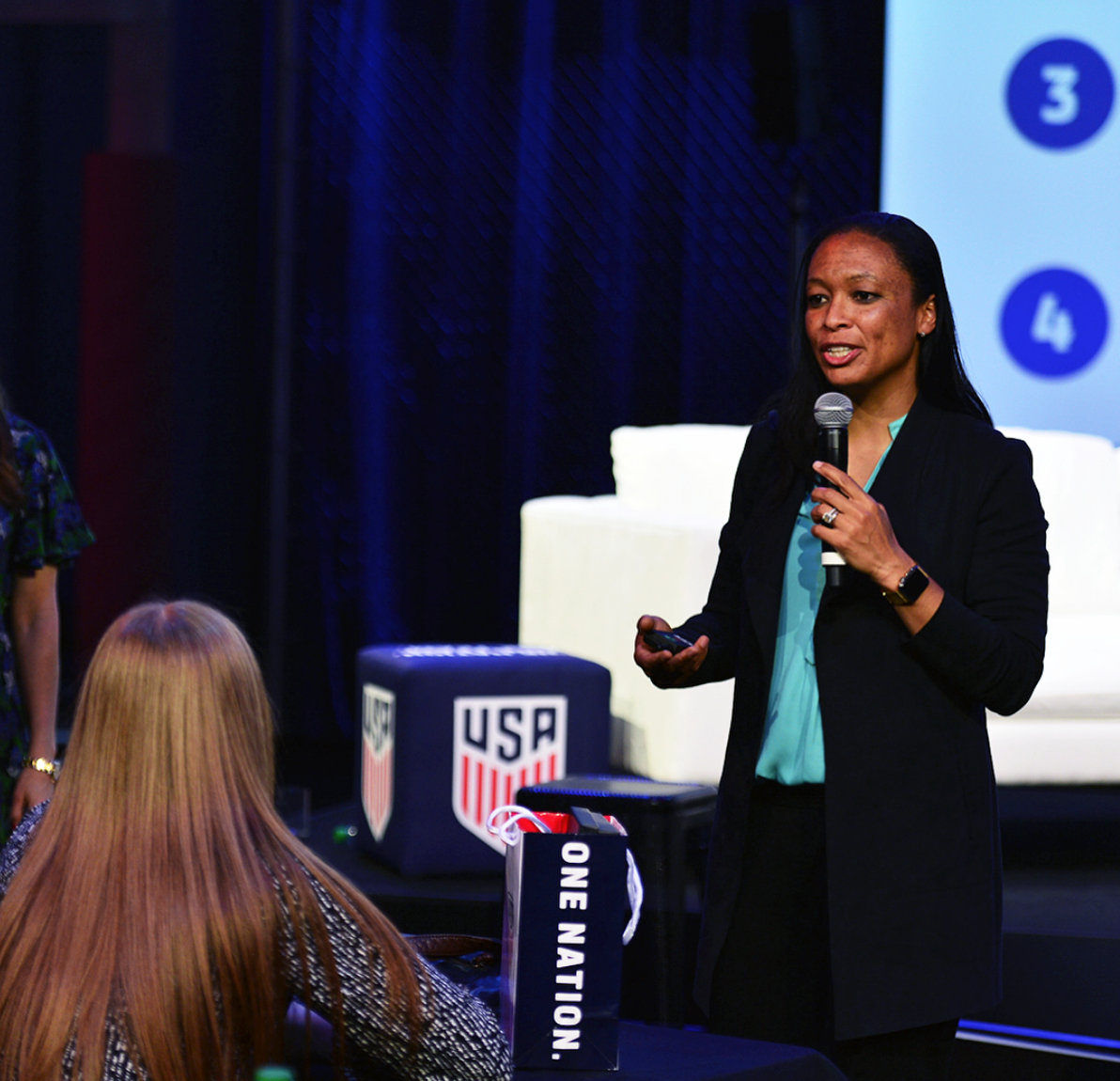 Former USWNT player Angela Hucles speaking at the SheBelieves Summit on March 3.