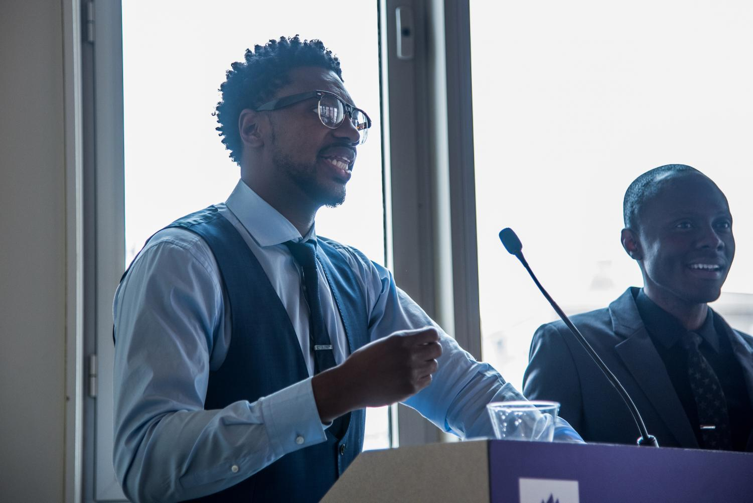 Marcus Johnson, DDS '08 (L), and Edly Destine, DDS '13, deliver the keynote address at a College of Dentistry brunch on March 4. Johnson started mentoring Destine years ago and they have remained friends since.