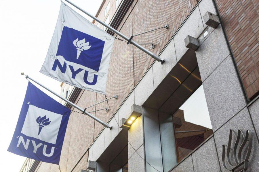 NYU%27s+flags+fly+outside+one+of+the+university%27s+buildings.
