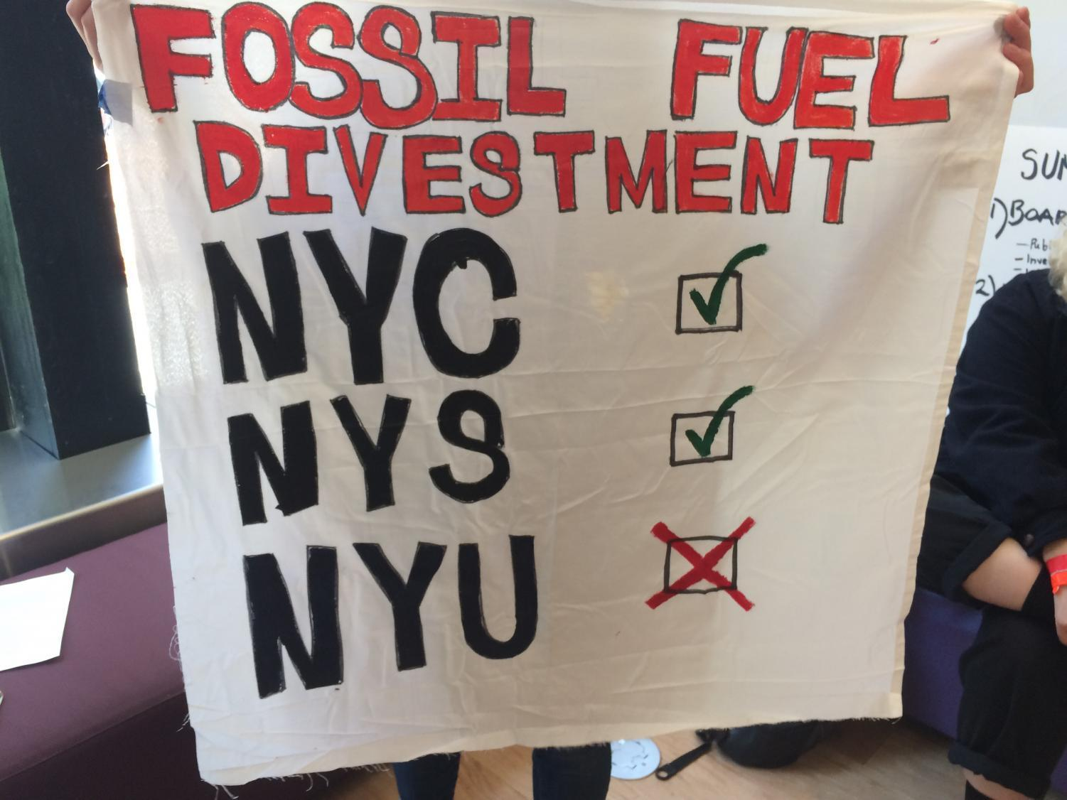 Demonstrators displayed posters advocating for fossil fuel divestment and improved student representation.