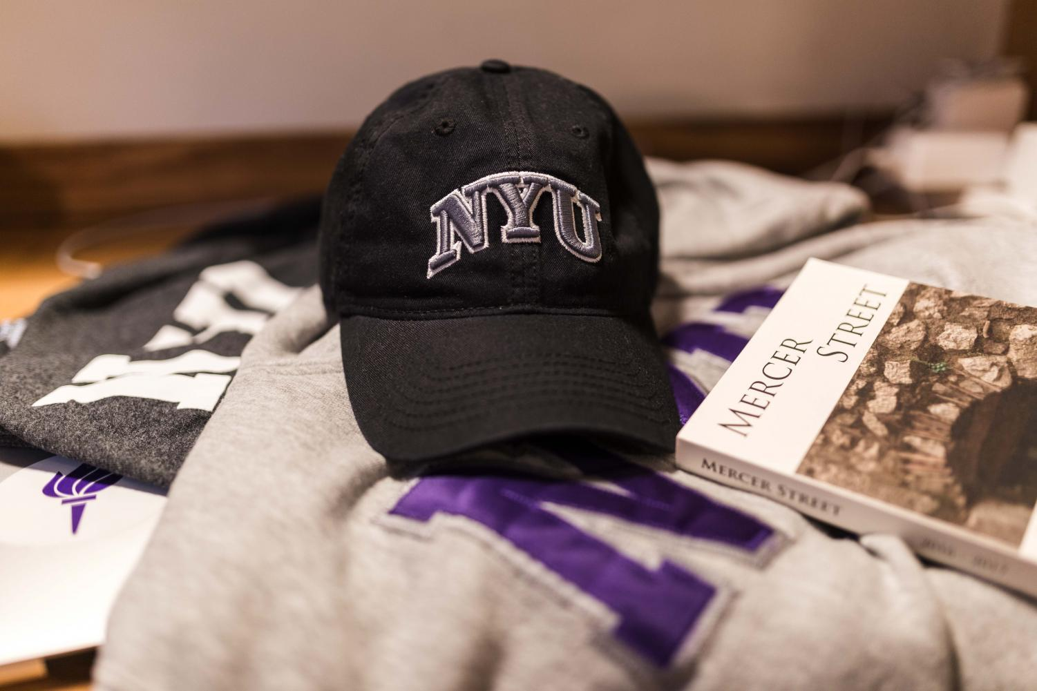 Various pieces of NYU merchandise from the NYU Bookstore.