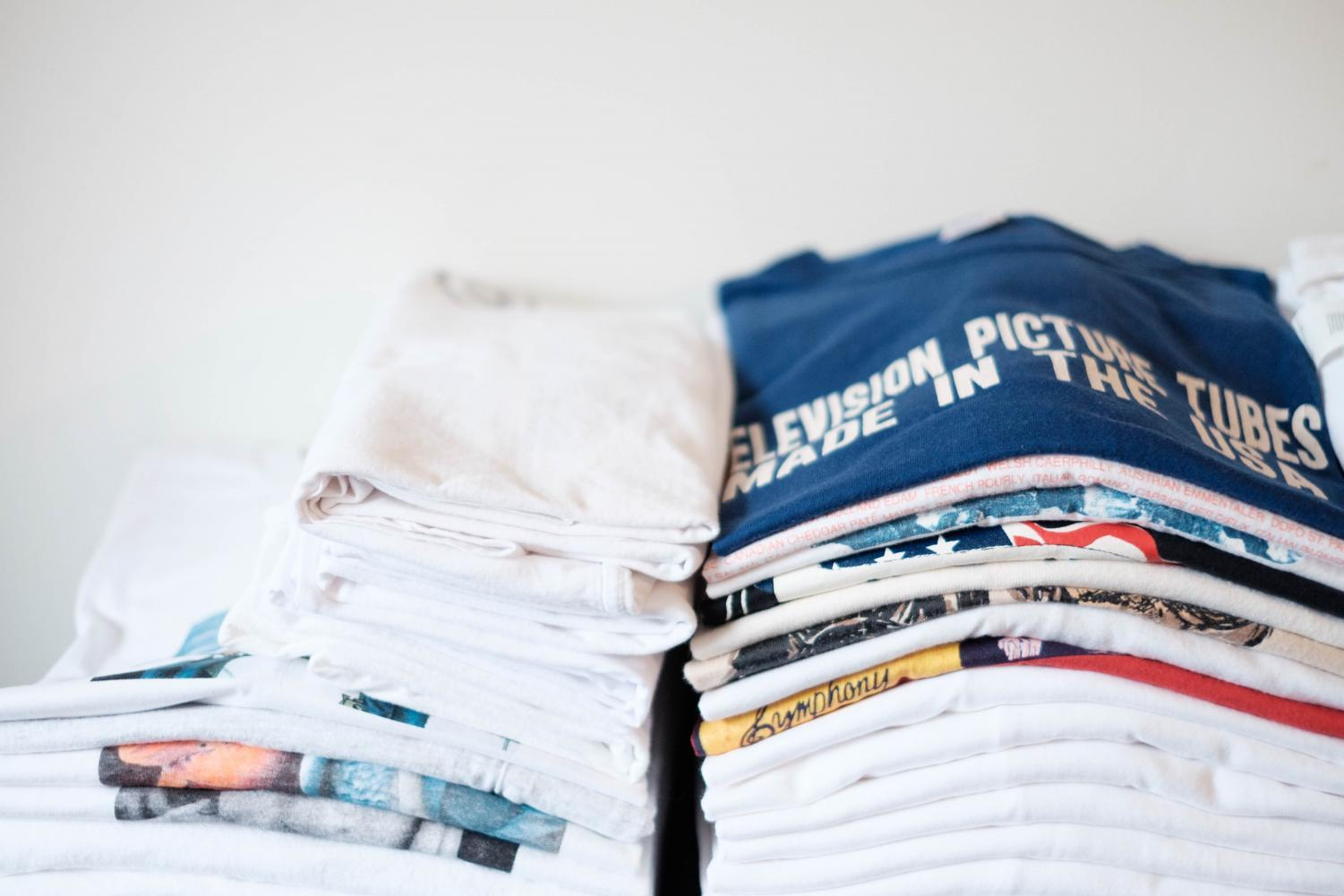 LS freshman Matias Mollin, also known as Matias the Broker on Grailed, has stacks of vintage T-shirts on his bed and ready to be shipped out to his customers.