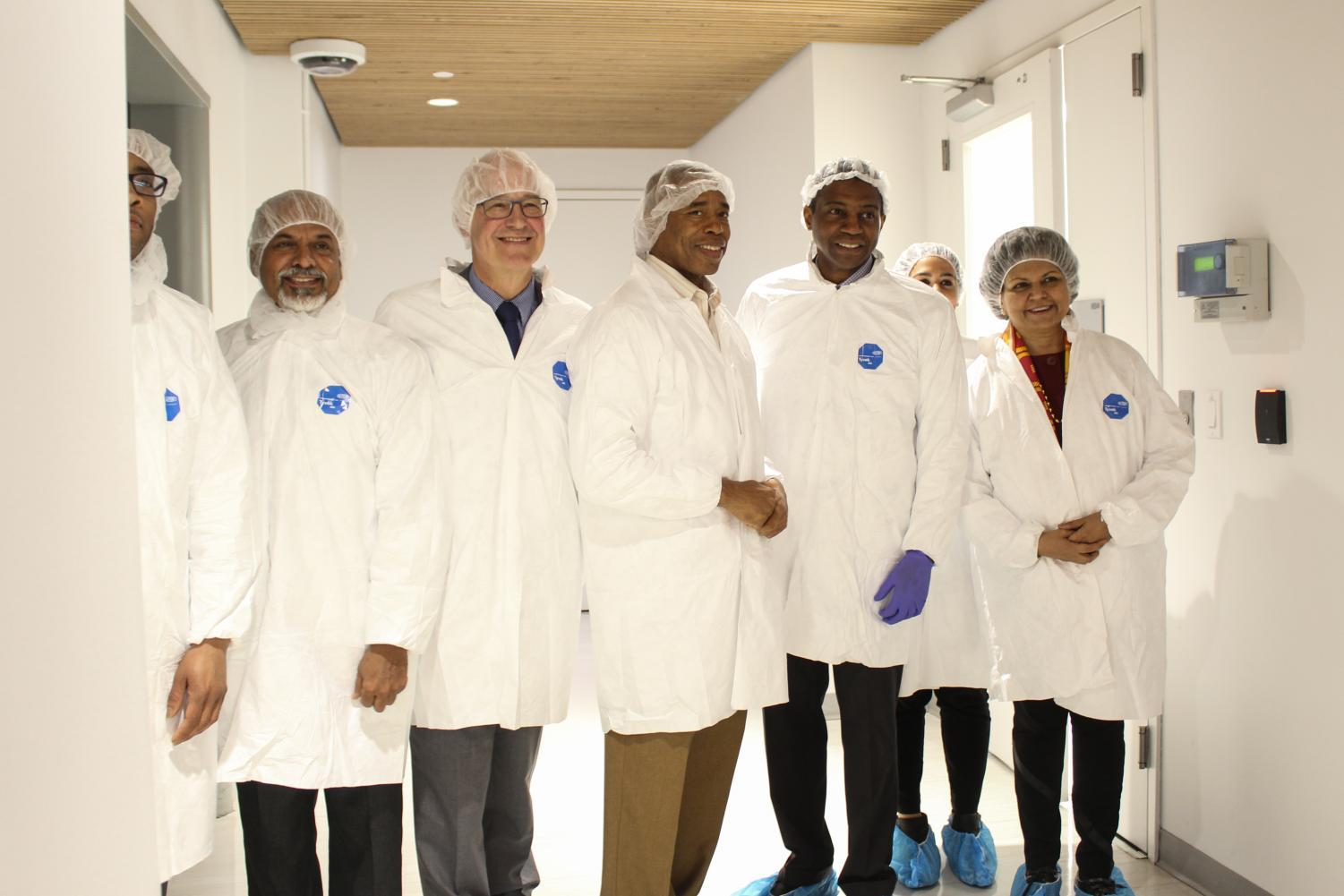 NYU administrators stand outside Tandon's new clean room