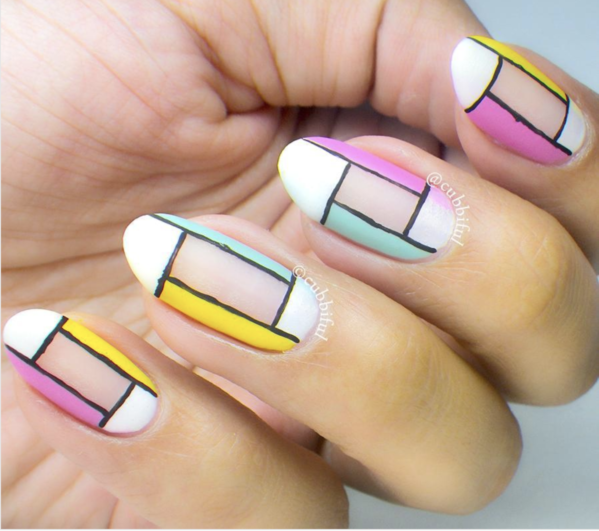 Color block nails from cubbiful, showcasing a current nail art trend.