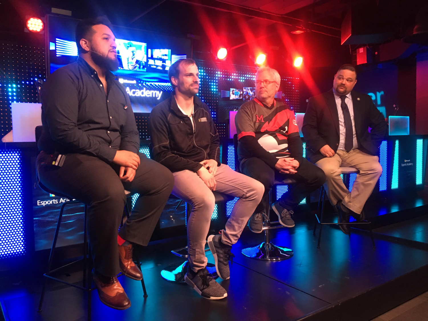 Panelists speak at an esports event at the Fifth Avenue flagship Microsoft Store.