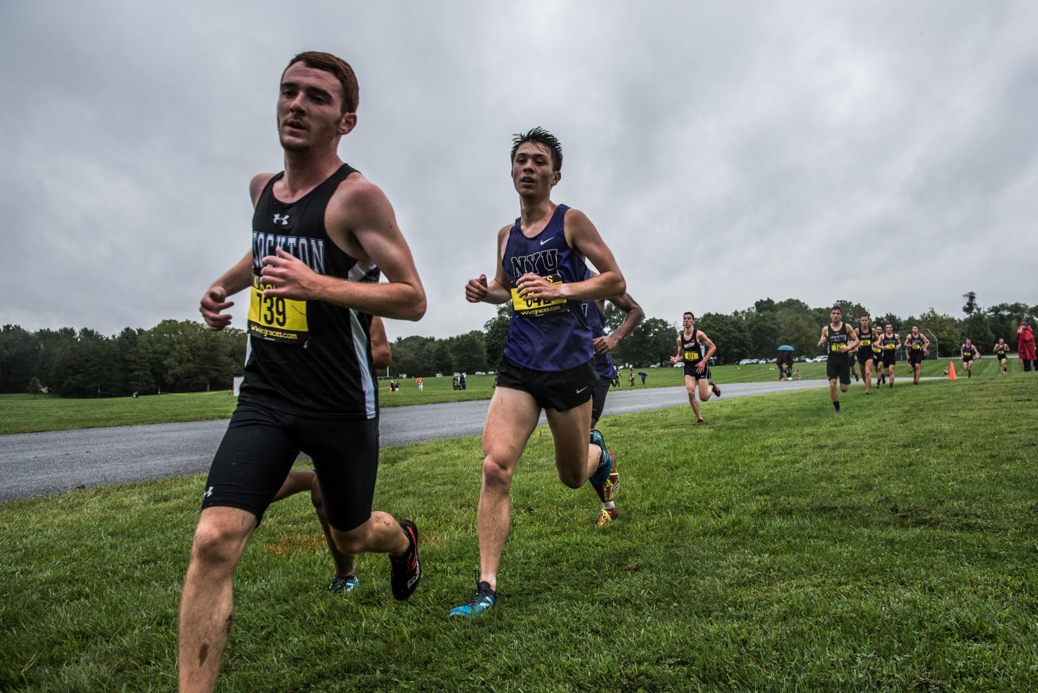Steinhardt junior Yuji Cusick (center) runs a cross-country race at the Ramapo College Season Opener on Friday, Aug. 31.